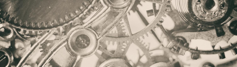 Uhrwerk Zahnräder die ineinander greifen um die Verzahnung von Unternehmen darzustellen und das Risiko des Vermögensschadens durch Vertrauensschaden Vertrauensschadenversicherung